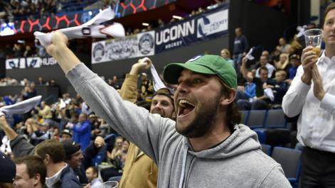 8000 Really Excited Guys in Whaler Hats: a fairly accurate sample of the crowd at UConn's Hockey East home opener.